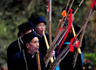 Miao people playing lusheng