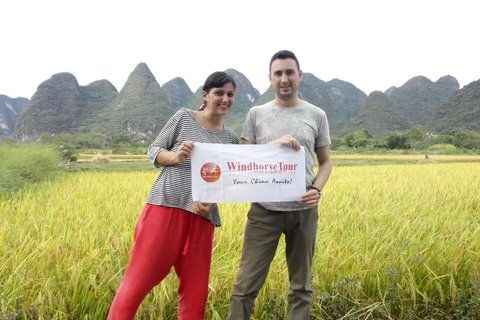 Marialuisa and Luca stand inside Yangshuo farm feild