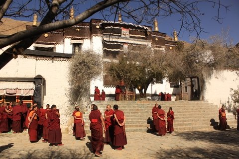 Monks inside of Tashilunpo Monastery